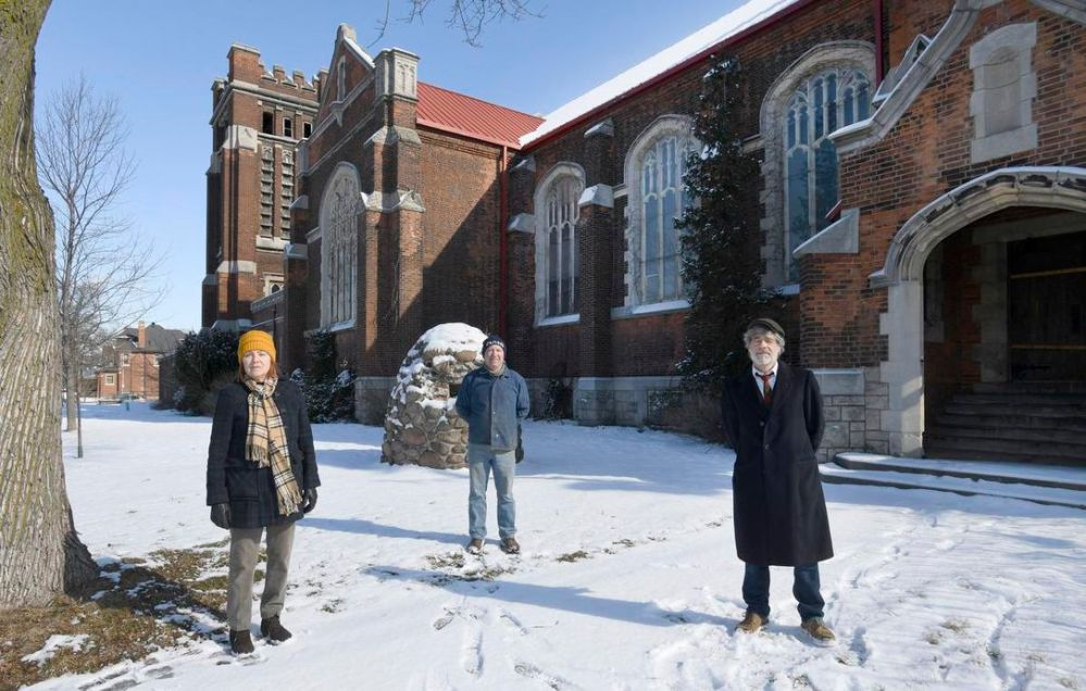 Janet Long, Walter Furlan, and Lance Darren Cole in front of St. Giles Church